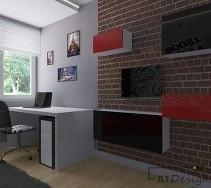 Imitacja ceglanej ściany z czarno - czerwonymi frontami szafek oraz białym biurkiem.