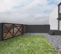 Ogrodzenie działki w odcieniach szarości połączone z surowymi drewnianymi deskami.