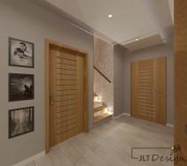 Korytarz w odcieniu beżu z drzwiami w kolorze naturalnego drewna.