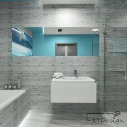 Lustro w łazience wkomponowane w szarą płytkę