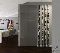 Szara szafa w projekcie korytarza w połączeniu z ciemnym drewnem podłogi.