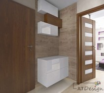 Ciemniejsze drzwi i ciekawa kolorystyka ścian korytarza wzbogacona geometrycznymi szafkami.