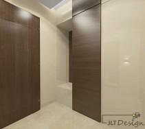 Elegancki korytarz z kontrastującymi frontami i drzwiami w ciemnym kolorze na tle beżu ścian.