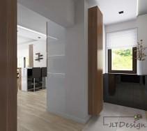 Duży, jasny projekt korytarza z dużym otwartym przejściem do innych pomieszczeń wnętrza.