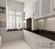 kuchnia z białymi ozdobnymi frontami, dzięki ktorym zyskuje na klasycznym i eleganckim wyglądzie. wszechobecna biel została przełamana ciemnym wybarwieniem blatu i mozaiką w odcieniach brązu.