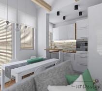 Biel na ścianach i duzych meblach ładnie połączona jest z dodatkami w neutralnych kolorach tworząc niezwykle czyste wnętrze. Idealne do domowego relaksu.