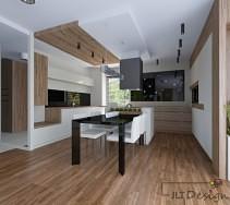 przestronna i minimalistyczna kuchnia z jadalnią. główną rolę odgrywa połączenie bieli w wysokim połysku z rysunkiem drewna - także na suficie. charakteru i elegancji nadają czarne dodatki.