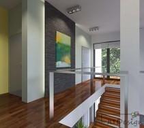 Antresola z kamienną ścianą i drewnianą podłogą