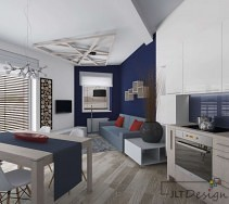 Nowoczesna kuchnia otwarta na salon w kolorach bieli i granatu
