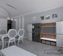 Zabudowa ściany z telewizorem w chłodnych odcieniach bieli i szarości