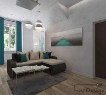 Brązowo beżowa kanapa w salonie z turkusowymi dodatkami