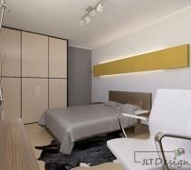 Zabudowana beżowa szafa w sypialni