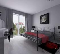Stalowe czarne łóżko w sypialni