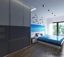 Sypialnia z morską aplikacją i ptakami zrywającymi się do lotu