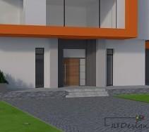 Jasne drzwi frontowe domu na tle jasnoszarej ściany zdobionej grafitem oraz pomarańczem.