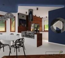 Duży, owalny stół, który idealnie pasuje do koloru szaf w kuchni