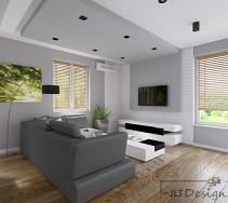 Białe meble i ciemna kanapa w jasnym salonie