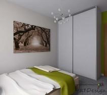 Duża szafa z białymi frontami oraz piękny krajobraz na białej ścianie sypialni z dodatkiem jaskrawej zieleni.