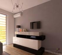 Biało-czarna, asymetryczna komoda na tle jasnoszarej ściany w niewielkiej sypialni.