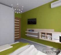 Zielona sypialnia z białymi i jasnobrązowymi dodatkami oraz oryginalną lampą