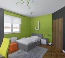 Łóżko w odcieniach szarości na tle zielonej ściany pokoju dziecięcego.