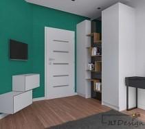 Intensywnie zielona ściana kontrastująca z bielą drzwi i mebli.