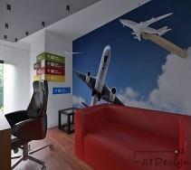 Designerski gabinet ze ścianą w samolotowe aplikacje oraz śliczną czerwoną sofką
