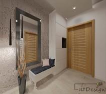 Oryginalny korytarz w kolorystyce łączącej szarość, krem i jasne drewno.