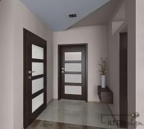 Przestronny korytarz w delikatnych barwach na ścianach i podłodze oraz wyraźnym kolorem drzwi.