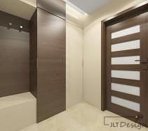 Elegancki korytarz z kontrastującymi frontami szafy i drzwiami w ciemnym kolorze na tle beżu ścian