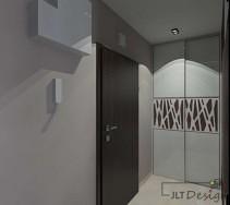 Jasny, szary projekt korytarza z ciekawym wzorem na frontach szafy oraz ciemnymi drzwiami wejściowymi.