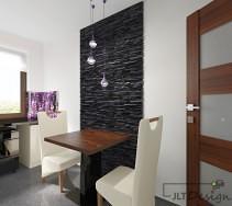 Ciemna ściana klinkierowa wkomponowana w nowoczesną kuchnię z zaaranżowanym małym 2 osobowym stołem