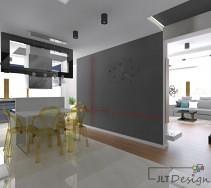 przestronna designerska kuchnia, połączona z jadalnią i otwarta na salon. jej centralnym punktem jest biały stół z niebanalnymi krzesłami z kolorowego przezroczystego tworzywa sztucznego.