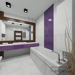 Duże lustro w łazience obudowane nietuzinkową linią drewna