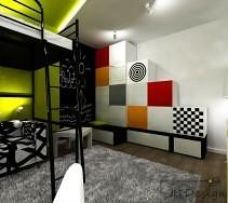 Kolorowe meble ustawione w pokoju dzieciecym połączone z ścianą pomalowaną farbą tablicową