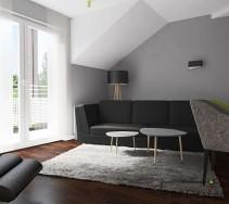 Czarna tapicerowana kanapa połączona z drewianymi stolikami