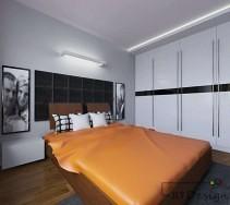 Nowoczesna sypialnia z dużą szafą w zabudowie i pomarańczową kapą