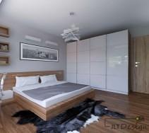 Biała szafa w zabudowie połączona z drewnianym łóżkiem i designerską lampą