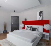 Białe łóżko z czerwonym zagłówkiem i zwisającymi lampami