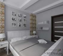 Białe meble w sypialni z kamieniem na ścianie