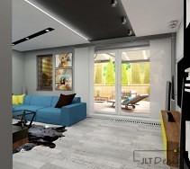 Jasny salon z ciekawym sufitem podwieszanym i niebieskim narożnikiem