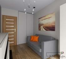 Szara sofa z kontrastującymi poduszkami w odcieniu soczystej pomarańczy umieszczona tuż pod obrazem z przedstawiającym piękny krajobraz. To połączenie idealnie prezentuje się na tle jasnoszarej ściany w niedużym pokoju.