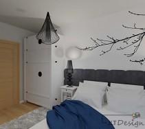 Biała szafa i interesująca czarna lampa